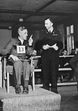 August Eigruber on the witness stand, Lt. Col. Denson on the right