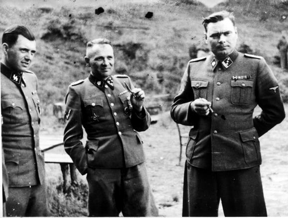 Left to right: Dr. Josef Mengele, Rudold Hoess, and Josef Kramer