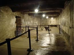 View of what tourists see inside the reconstructed gas chamber in the main Auschwitz camp