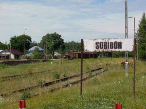 Sign alongside the railroad tracks for stop at Sobibor