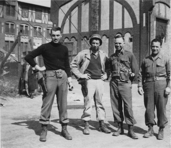 The man on the far left is the real-life George Stout