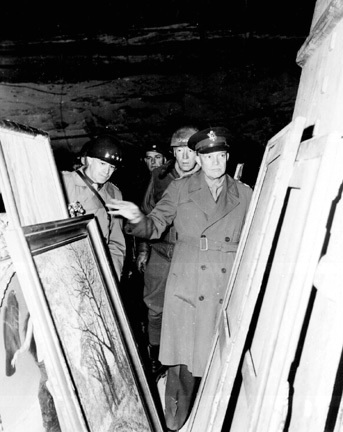General Eisenhower inspects the art stored in the Merkers salt mine