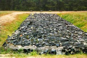 Memorial stones of basalt recreate pits where bodies were burned