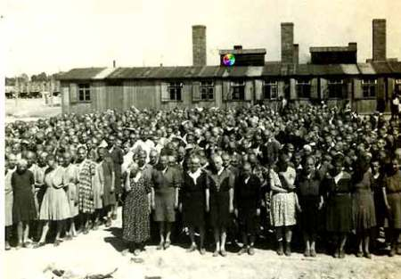 Women lined up in front of a building at Auschwitz-Birkenau
