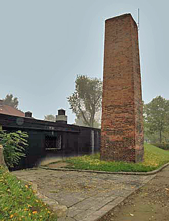 My 2005 photo of the Auschwitz chimney shows that it is not connected to the building