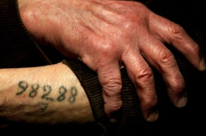 A number tattooed on the arm of a Holocaust survivor