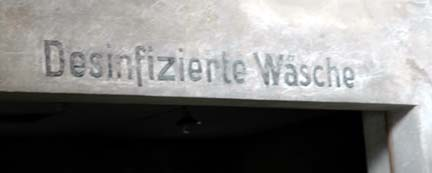 Sign over the room at Auschwitz where Jews were disinfected to  kill head lice
