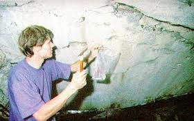 Germar Rudolf inside Krema II, taking samples from the wall