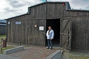José Ángel standing in front of Building No. 52 at Majdanek