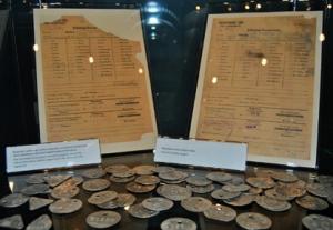 Round badges worn by prisoners at Majdanek Photo Credit: José Ángel
