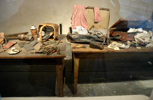 A display table inside the Sauna building at Auschwitz-Birkenau