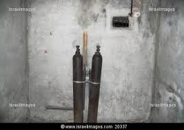 Two cylinders inside the Majdanek gas chamber