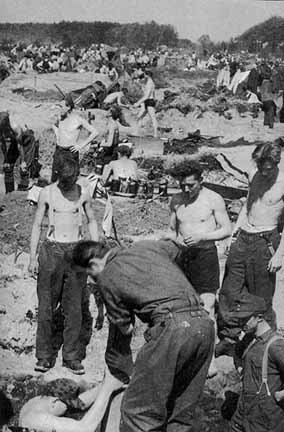 German POWs digging  holes for shelter in Eisenhower's  death camp