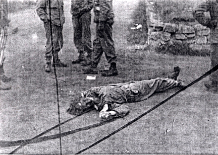 The body of a German soldier at Dachau is believed to be the body of Lt. Wicker who surrendered the camp
