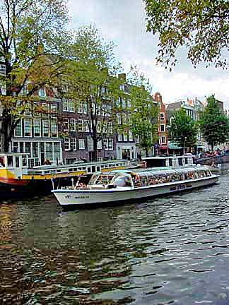 A canal boat passing the Anne Frank house in Amsterdam