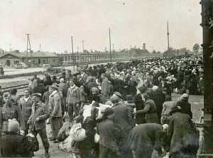 Men and women getting off an in-coming train at the Auschwitz II camp, aka Auschwitz-Birkenau