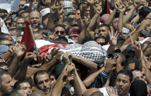 The body of a Palestinian teenager who was burned alive by Jews in Israel