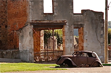 The famous old car with a building in the background