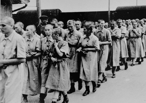 Hungarian women walking toward the women's camp at Auschwitz-Birkenau after their heads were shaved