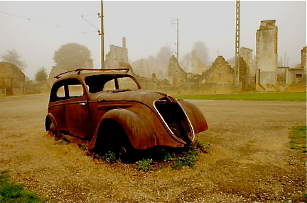 Old car with the fairgrounds in the background