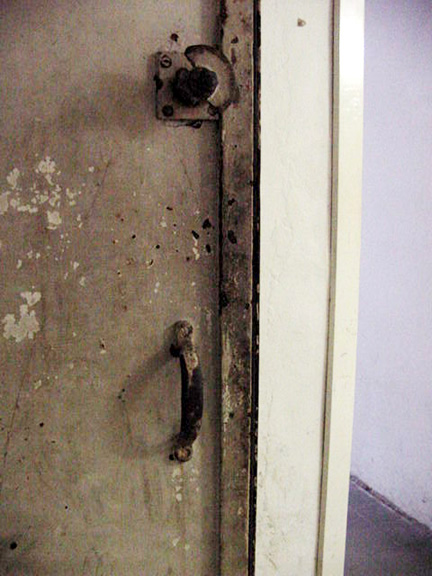 Door latch on the inside of the Mauthausen gas chamber has no handle