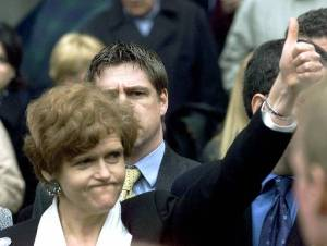 Deborah Lipstadt gives a victory salute after defeating David Irving in his libel lawsuit against her