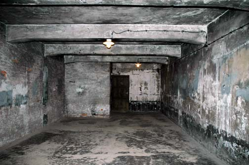 Wooden door is shown in the background of a photo of the gas chamber