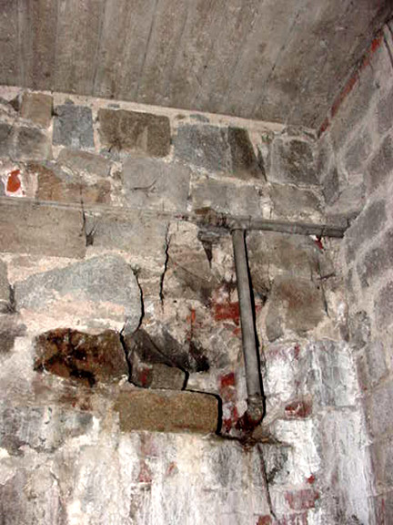 Water pipe in the Mauthausen morgue goes through the wall into the gas chamber