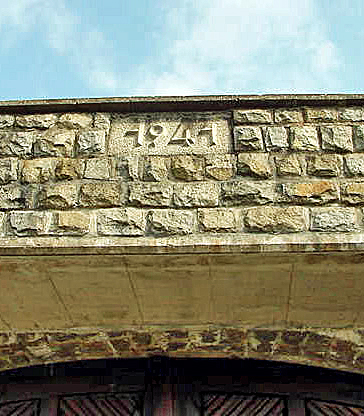 My 2003 photo of the 1941 sign over the gate into Mauthausen