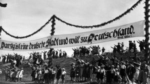 1939 photo shows ethnic Germans in Danzig saluting under a banner which says that Danzig is  a German city