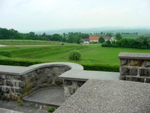 Wall around the Mauthausen camp with the Austrian countryside in the background