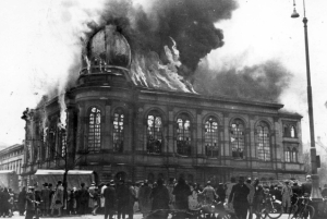 Spectators watch as a synagogue burns in Germany in 1938