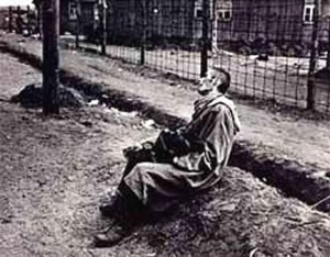 Dying man at the Bergen-Belsen camp when it was turned over to the British