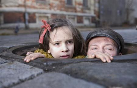 "Scene from the movie ""In Darkness, shows children hiding the sewer"