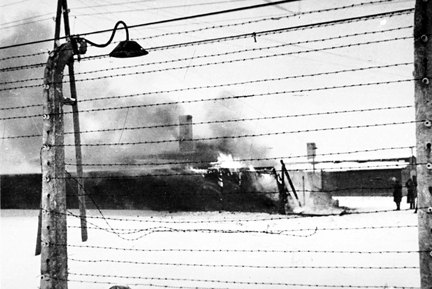 The Kanada warehouses burning after the Germans abandoned Auschwitz