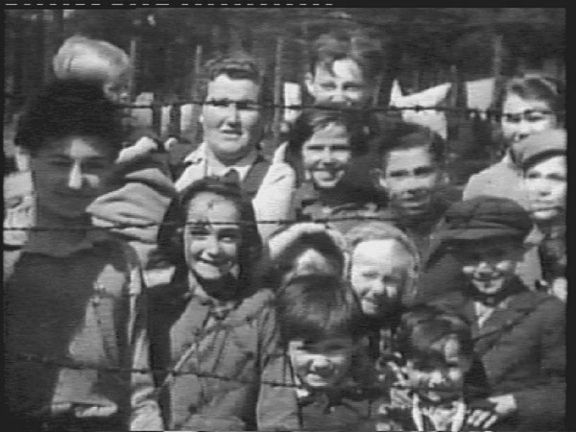 """Photo of the children in Bergen-Belsen who came out to meet the British """"liberators"""" of the camp"""
