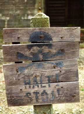 A faded original sign at the Auschwitz main camp