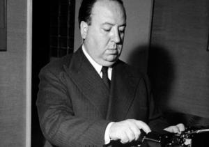 Alfred Hitchcock typing with one finger, back in the day when he worked on propaganda films