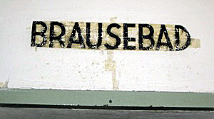Sign over the door into the shower room at Dachau