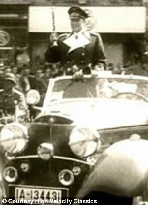 Hermann Goering riding through the streets of Nazi Germany