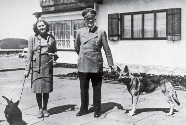 Hitler and his girlfriend with their dogs