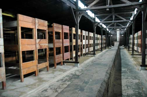 Bunk beds in the quarantine barracks which are shown to tourists at Auschwitz-Birkenau