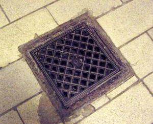 Floor drain in Mauthausen shower room