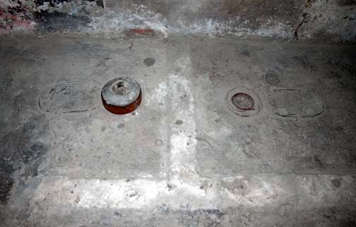 Toilet drains in the Auschwitz gas chamber