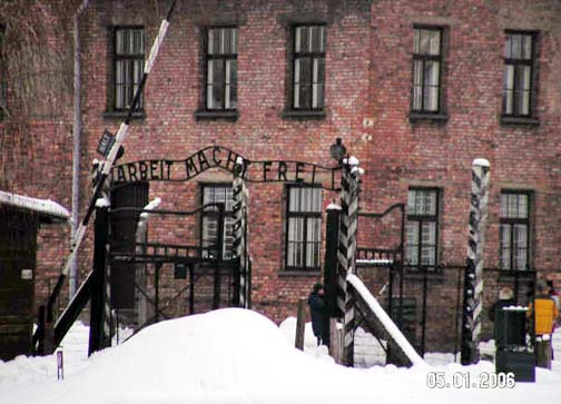 Arbeit Macht Frei gate with Block 24 in background, January 2006 Photo Credit: José Ángel López