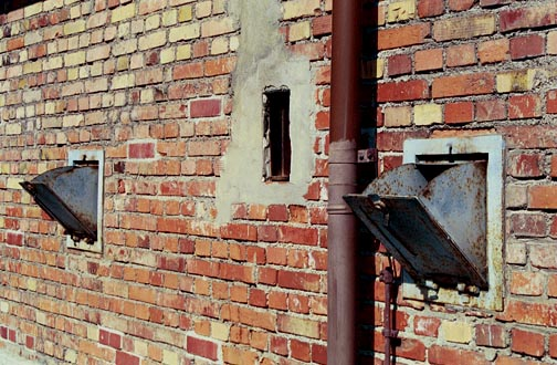 Bins on the outside wall of the Dachau gas chamber