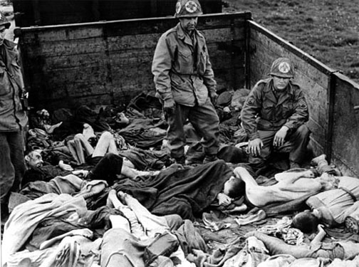 American soldiers examine the bodies found on the