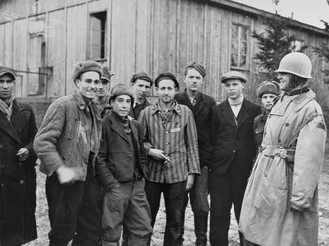 Col. Hayden Sears poses with survivors of the Ohrdruf camp on April 8, 1945 -- four days after the camp was liberated