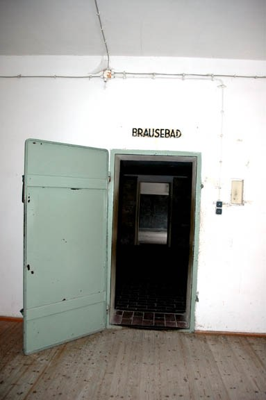 Door into the Dachau gas chamber with wiring going into the room