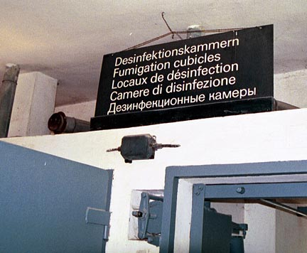 Notice the two pipes on the wall above the doors into the disinfection chambers at Dachau
